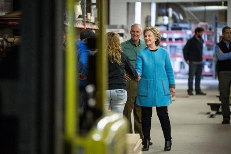 Fashion - KEENE, NH - APRIL 20: Democratic presidential hopeful and former U.S. Sectetary of State Hillary Clinton ahakes hands as she arrives to speak to employees of Whitney Brothers, an educational furniture manufacturer, at a round table discussionon April 20, 2015 in Keene, New Hampshire. This marks Clinton's first major political event in New Hampshire after announcing her campaign for president a little over a week ago. (Andrew Burton/Getty Images)